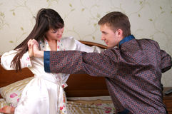 Young couple have a fun fight Royalty Free Stock Photo