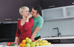 Young couple have fun in modern kitchen Royalty Free Stock Photo
