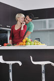 Young couple have fun in modern kitchen Royalty Free Stock Photos