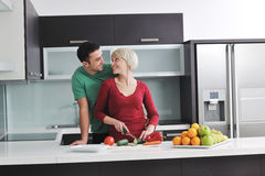 Young couple have fun in modern kitchen Royalty Free Stock Image