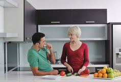 Young couple have fun in modern kitchen Stock Photos