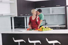 Young couple have fun in modern kitchen Stock Images