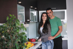 Young couple have fun in modern kitchen Stock Image