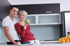 Young couple have fun in modern kitchen Royalty Free Stock Images