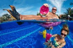 Fun in swimming pool Stock Photos