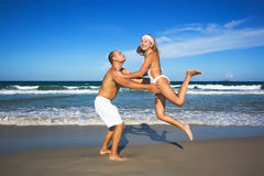 Young couple have a fun time on the beach Stock Images