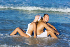 Young couple have a fun time on the beach Stock Image