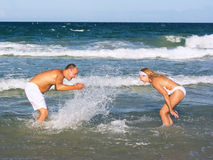 Young couple have a fun time on the beach Stock Photo
