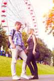 Young couple have good time in summer park Royalty Free Stock Photo
