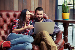 Young couple have a on-line shopping. Smiley young couple have a on-line shopping Royalty Free Stock Images