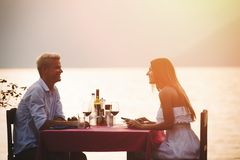 Young couple have romantic evening on sea beach stock photos