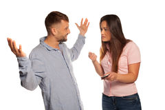 Young couple having an argument with defensive man Stock Image
