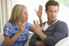 Young Couple Having Argument At Home Royalty Free Stock Images
