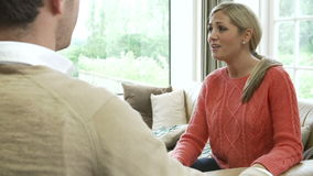 Young Couple Having Argument At Home. View over man's shoulder as he argues with wife at home.Shot on Sony FS700 in PAL format at a frame rate of 25fps stock footage