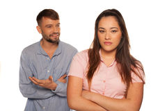 Young couple having an argument with man talking Royalty Free Stock Image