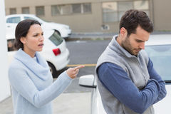 Young couple having an argument. Outside their car Royalty Free Stock Photo