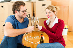 Young couple having break while moving in Stock Photo