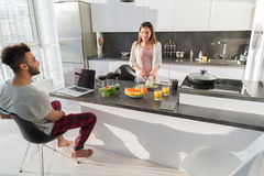 Young Couple Having Breakfast, Asian Woman Hispanic Man Cooking Food Kitchen Stock Image