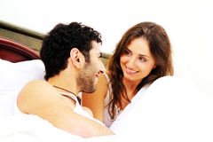 Young couple having breakfast in bed Royalty Free Stock Photography