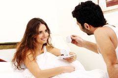 Young couple having breakfast in bed Royalty Free Stock Images