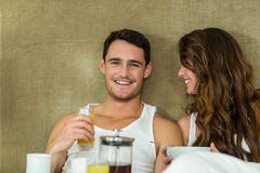 Young couple having breakfast on bed Stock Photography