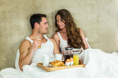 Young couple having breakfast on bed Stock Image