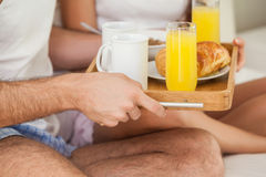 Young couple having breakfast in bed Royalty Free Stock Image