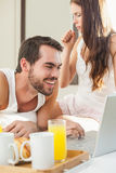 Young couple having breakfast in bed Royalty Free Stock Photo