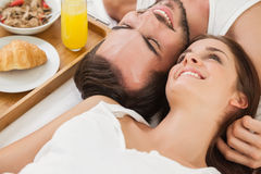 Young couple having breakfast in bed Stock Photography