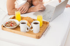 Young couple having breakfast in bed Stock Image