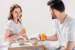 young couple having breakfast in bed in morning together royalty free stock image