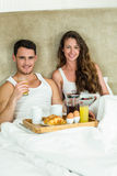 Young couple having breakfast on bed Royalty Free Stock Photo