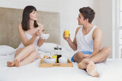 Young couple having breakfast on bed Royalty Free Stock Image