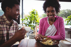 Young couple having breakfast in cafeteria Royalty Free Stock Image