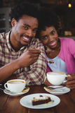 Young couple having breakfast in cafeteria Royalty Free Stock Photography