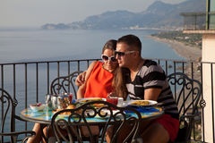 Young couple having breakfast on hotel Royalty Free Stock Image