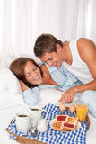 Young couple having breakfast together Royalty Free Stock Image