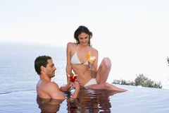 Young couple having a cocktail Royalty Free Stock Image