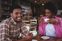 Young couple having coffee in cafeteria Royalty Free Stock Photos
