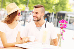 Young couple having coffee Stock Images
