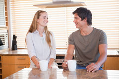 Young couple having a cup of coffee Royalty Free Stock Photos