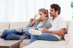 Young couple having a cup of tea Stock Image