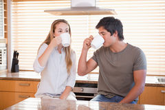 Young couple having a cup of tea Stock Photos
