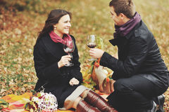 Young couple having date in autumn park Stock Images