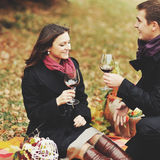 Young couple having date in autumn park Royalty Free Stock Photography