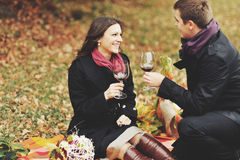 Young couple having date in autumn park Stock Photo