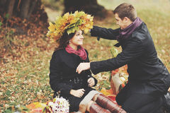 Young couple having date in autumn park Stock Photos