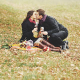 Young couple having date in autumn park. Stock Photos