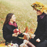 Young couple having date in autumn park Royalty Free Stock Photos