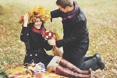 Young couple having date in autumn park. Stock Photo